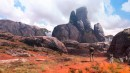 Red Earth - Uncharted 4 - The island of Madagascar is one of the key locations in video game Uncharted 4 in the search for the pirate treasure of Captain Avery. The artists at Naughty Dog tried a range of different looks for Madagascar's unique landscape. From lush and full scenes to dry and arid places, the distinctive granite boulders and intense-looking red earth provided *cough* fertile ground for the artists to explore the scenery. As per usual, an Uncharted 4 game character – in this case Nathan Drake himself - was inserted for scale. This image was made by Naughty Dog's concept artist Nick Gindraux.